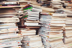 Piles of colorful comics magazines in a flea market Stock Image