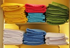 Piles of colorful towels. On shelves in shop Stock Photography