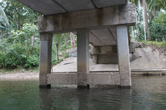 Piles of concrete bridge over small river. 1 Royalty Free Stock Photos