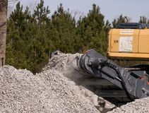 Concrete Crushing Operation V. Piles of concrete construction debris are recycled into crushed concrete for site foundation construction Royalty Free Stock Photography