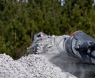 Concrete Crushing Operation VII. Piles of concrete construction debris are recycled into crushed concrete for site foundation construction Royalty Free Stock Images