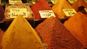 Piles of condiments in turkish bazaar. Herbs condiments and spices market in turkey in a traditional bazaar stock footage