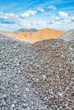 Piles of construction sand and gravel on Stock Images