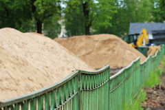 A piles of construction sand on the site for the construction of the city stadium. Stock Photography