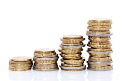 Piles croissantes de pièces de monnaie Photographie stock