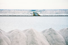 Piles of crystallised salt at a saline refinery Royalty Free Stock Image