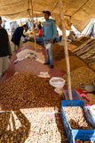 Piles of dates, nuts and dried fruits in the market. Photo taken in an open space weekly held market in Morocco Stock Photography