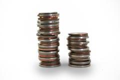 Piles de pièces de monnaie images stock