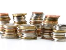 Piles de pièces de monnaie d'argent Photographie stock libre de droits