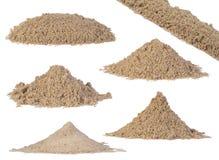 Piles de sable d'isolement sur le blanc Images libres de droits