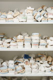 Piles of dentures on several shelves close up shot stock photo