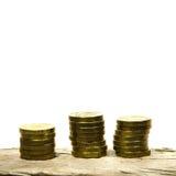 Piles des pièces de monnaie d'or Images stock