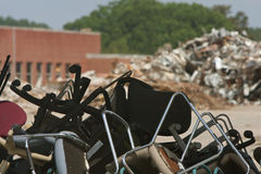 Piles Of Discarded Office Chairs And Debris At Demolition Site Stock Image