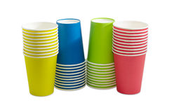Piles of the disposable paper cups in different colors Stock Photos