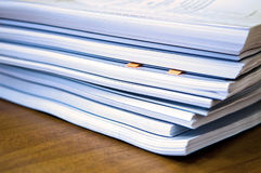 Piles of documents. Lying on a table Royalty Free Stock Images