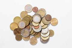 Piles of Euro coins. Isolated stock photography