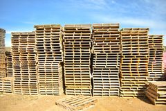 piles of european pallets made in wood ready to be used transporting products or goods on them from a place to other by truck, royalty free stock images