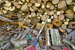 Piles of Firewood with Axe Royalty Free Stock Photography