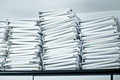 Piles of folders in office. Close up of piles of white folders containing papers in office Royalty Free Stock Image