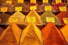 Piles of fresh bright colorful local turkish spice ingredient in Istanbul spice market including curry, paprika, masala, mint Royalty Free Stock Photography