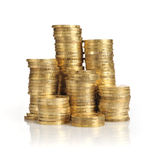 Piles of gold coins. Different height piles of gold coins isolated on white background Royalty Free Stock Photography