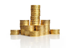 Piles of gold coins. Different height piles of gold coins isolated on white background stock photos