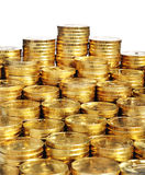 Piles of gold coins. On white background Royalty Free Stock Image