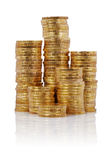 Piles of gold coins Stock Images