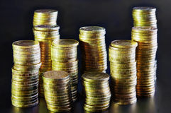 Piles of gold coins Royalty Free Stock Image