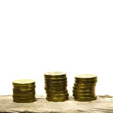 Piles of golden coins Stock Images