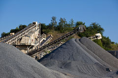 Piles of gravel. Conveyor belts with piles of gravel Royalty Free Stock Photos