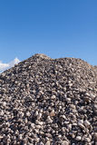 Piles of Gravel at Construction Site under Bright Blue Sky Royalty Free Stock Photography