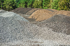 Piles of gravel and mixed sand on construction Royalty Free Stock Photos