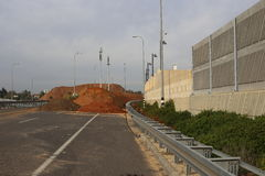 In construction highway blocked with Piles of ground  Stock Images