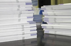 Piles of Handout Pamphlets. Piles of handout papers lying on a table Royalty Free Stock Image