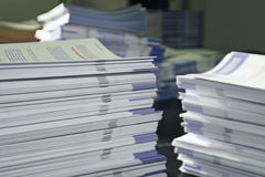 Piles of Handout Pamphlets. Piles of handout papers lying on table stock photos
