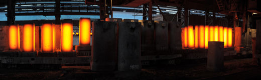 Piles of hot iron blocks Stock Image