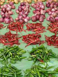 Piles of hot peppers and onions Royalty Free Stock Images