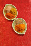 Piles of indian powder spice  red glitter Stock Photo