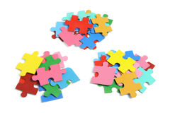 Piles of Jigsaw Puzzle Pieces. On White Background Royalty Free Stock Photos