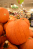 Piles of large pumpkins in grocery store. Royalty Free Stock Images
