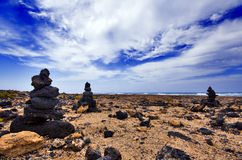 Piles of lavastones. Three piles of lavastones at the north coast of Fuerteventura royalty free stock image
