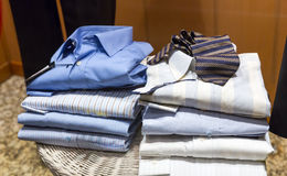 Piles of male shirts Royalty Free Stock Images