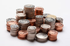 Piles of money Stock Images