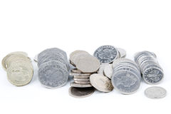 Piles of money. Piles of British coins in a row Royalty Free Stock Photo
