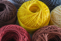 Piles of multi colored balls yarn Royalty Free Stock Image