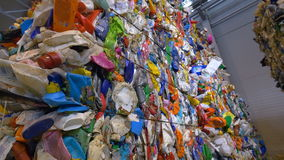 Piles of multicolor PET bottles in plastic recycling factory. stock video footage