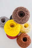 Piles of multicolored balls yarn background Stock Photo