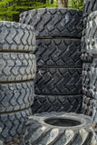 Piles of new and old machinery tires Royalty Free Stock Photo