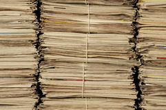 Piles of newspapers to be recycled Stock Images